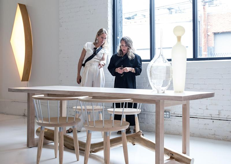 Light wood and other Scandinavian undertones attracted Nellemann and Castle to a Ralph Pucci dining table by Chris Lehrecke and Gabriella Kiss. The chairs are by Lehrecke.