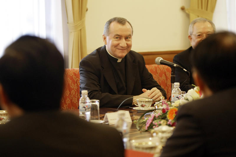 FILE - In this Feb. 16, 2009 file photo Monsignor Pietro Parolin, center, smiles during a meeting in Hanoi, Vietnam. The Vatican announced Saturday, Aug. 31, 2013 that the Italian archbishop, Pietro Parolin, 58, will take up the post held since 2006 by Italian Cardinal Tarcisio Bertone, starting Oct. 15. Pope Francis has tapped a veteran Vatican diplomat to replace the Holy See's secretary of state who in recent years increasingly became a divisive figure in the Catholic church's hierarchy. (AP Photo/Chitose Suzuki, file)