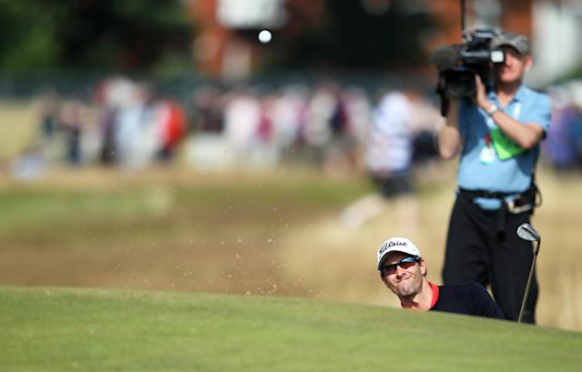 Australia's Adam Scott plays out of a bunker on the second hole during his second round of the British Open Golf Championship at Royal Liverpool Golf Course in Hoylake, north west England on July 18, 2014 (AFP Photo/Peter Muhly)
