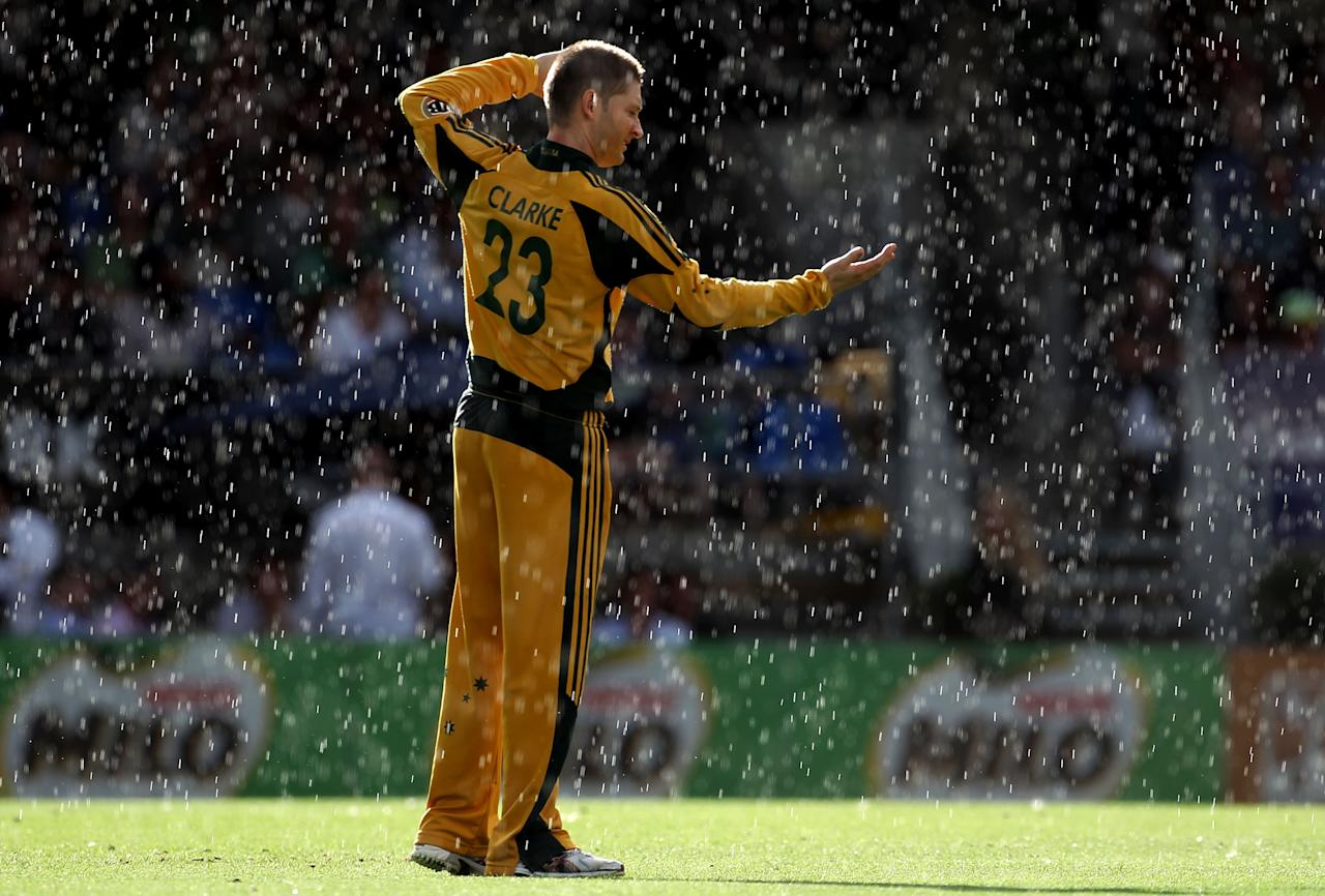 AUCKLAND, NEW ZEALAND - MARCH 06: Michael Clarke of Australia holds out his hand into the rain during the Second One Day International match between New Zealand and Australia at Eden Park on March 6, 2010 in Auckland, New Zealand.  (Photo by Phil Walter/Getty Images)