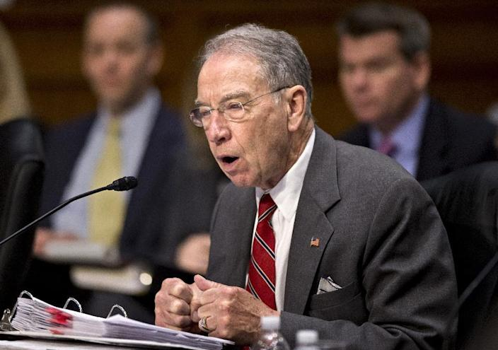 Sen. Chuck Grassley, R-Iowa, the ranking Republican on the Senate Judiciary Committee makes a point on Capitol Hill in Washington, Monday, May 20, 2013, as lawmakers work on a landmark immigration bill to secure the border and offer citizenship to millions. The panel is aiming to pass the legislation out of committee this week, setting up a high-stakes debate on the Senate floor. (AP Photo/J. Scott Applewhite)