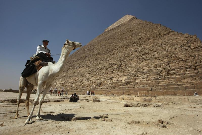 Egypt has recovered fragments from the pyramid of Cheops said to have been stolen by Germans, including part of a stone tablet identifying the pharaoh it was named after, state media report