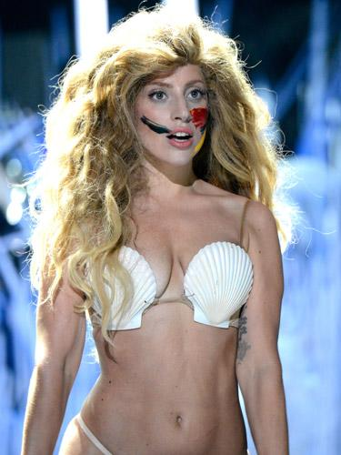 """<div class=""""caption-credit""""> Photo by: Getty Images</div><div class=""""caption-title"""">The Inspiration</div><p>  Lady Gaga definitely knows how to put on a show. Among her many looks, we were especially taken with her mermaid hair and paint smudges (to replicate her album cover) at <a rel=""""nofollow"""" href=""""http://www.realbeauty.com/health/wellness/weirdest-moments-vmas-2013?link=rel&dom=yah_life&src=syn&con=blog_bea&mag=bea"""" target=""""_blank"""">this year's VMAs</a> . Check out our DIY tutorial to get this look for Halloween.  <br> </p>"""