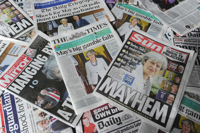 <p>British daily newspapers showing front page stories about the exit poll results of the snap general election in London on June 9, 2017. (Photo: Daniel Sorabji/AFP/Getty Images) </p>