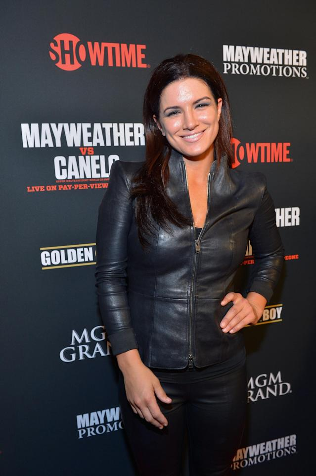 LAS VEGAS, NV - SEPTEMBER 14: Actress and former mixed martial artist Gina Carano arrives at the MGM Grand Garden Arena for the Floyd Mayweather Jr. vs. Canelo Alvarez boxing match on September 14, 2013 in Las Vegas, Nevada. (Photo by Bryan Steffy/Getty Images for Showtime)