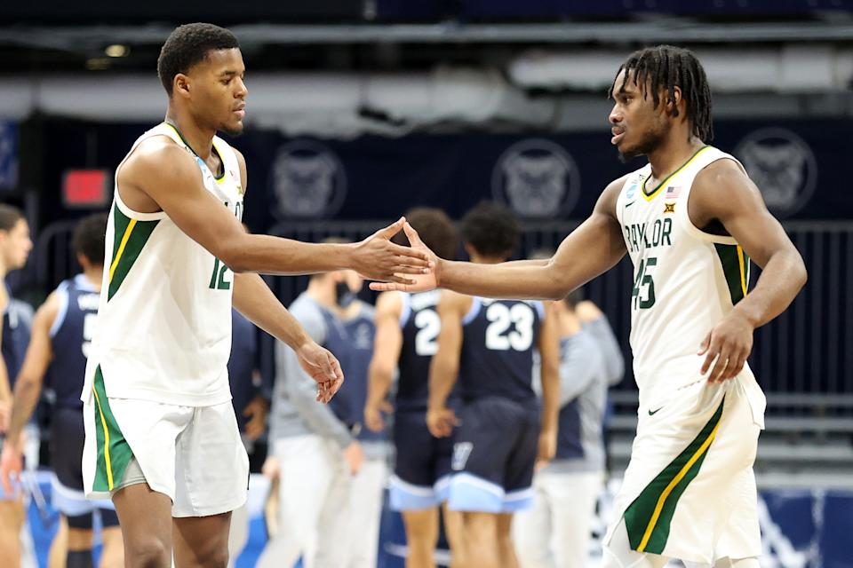 INDIANAPOLIS, INDIANA - MARCH 27: Jared Butler #12 and Davion Mitchell #45 of the Baylor Bears react in the second half of their Sweet Sixteen game against the Villanova Wildcats in the 2021 NCAA Men's Basketball Tournament at Hinkle Fieldhouse on March 27, 2021 in Indianapolis, Indiana. (Photo by Andy Lyons/Getty Images)
