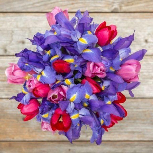 """<p>bouqs.com</p><p><a href=""""https://go.redirectingat.com?id=74968X1596630&url=https%3A%2F%2Fbouqs.com%2Fflowers%2Fteachers-day%2Fpink-tulips-iris&sref=https%3A%2F%2Fwww.countryliving.com%2Fshopping%2Fgifts%2Fg25846001%2Fteacher-valentine-gifts%2F"""" rel=""""nofollow noopener"""" target=""""_blank"""" data-ylk=""""slk:Shop Now"""" class=""""link rapid-noclick-resp"""">Shop Now</a></p><p>You can't go wrong with flowers, especially with a name as fitting as this bouquet's: Heartfelt. </p>"""