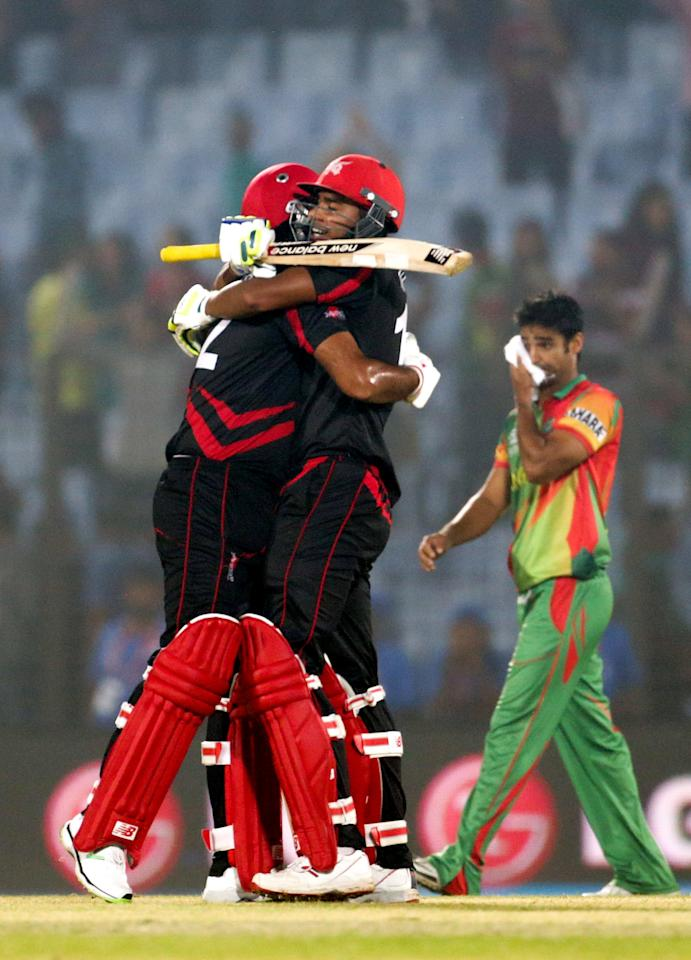 Nadeem Ahmed and Haseeb Amjad of Hong Kong celebrate their victory over Bangladesh following the Bangladesh v Hong Kong match at the ICC World Twenty20 Bangladesh 2014 played at Zahur Ahmed Chowdhury Stadium on March 20, 2014 in Chittagong, Bangladesh. (Photo by Graham Crouch-IDI/IDI via Getty Images)