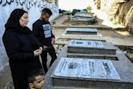 Sayed Bakr, who survived the airstrike that killed four of his relatives, visited his brother's grave with his mother in the Al-Shati refugee camp in Gaza City