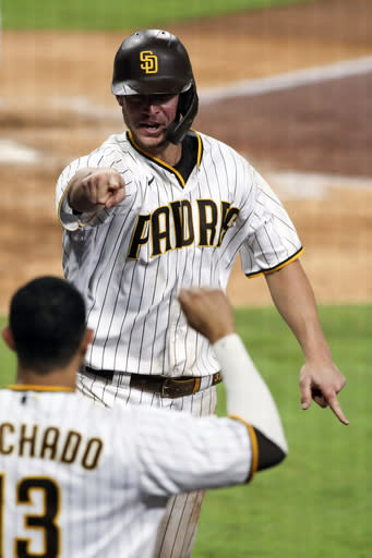 San Diego Padres' Wil Myers reacts after hitting a solo home run against the Los Angeles Dodgers in the eighth inning of a baseball game Monday, Sept. 14, 2020, in San Diego. (AP Photo/Derrick Tuskan)