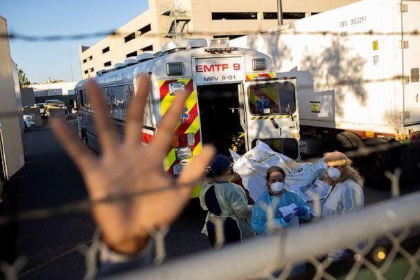 PHOTO: An El Paso County Sheriff's Officer tries to block photographs from being taken as bodies are moved to refrigerated trailers during a surge of coronavirus disease deaths, outside the El Paso Medical Examiners Office in Texas, Nov. 16, 2020. (Ivan Pierre Aguirre/Reuters)