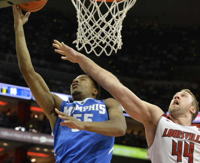 Memphis' Geron Johnson, left, is fouled by Louisville's Stephan Van Treese while attempting to shoot during the first half of an NCAA college basketball game on Thursday Jan. 9, 2014, in Louisville, Ky. (AP Photo/Timothy D. Easley)