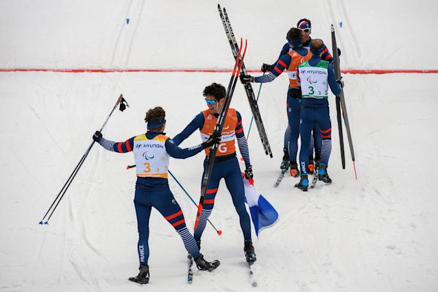 Benjamin Daviet FRA (L) and team-mates celebrate after France won the Cross Country Skiing 4x2.5km Open Relay at the Alpensia Biathlon Centre. The Paralympic Winter Games, PyeongChang, South Korea, Sunday 18th March 2018. OIS/IOC/Thomas Lovelock/Handout via Reuters