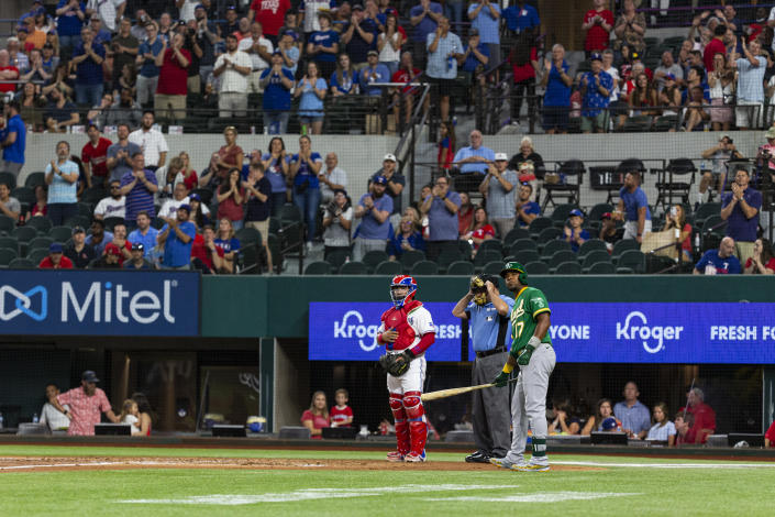 Oakland Athletics' Elvis Andrus (17) waits to take an at-bat during the second inning of a baseball game against the Texas Rangers, Monday, June 21, 2021, in Arlington, Texas. (AP Photo/Sam Hodde)
