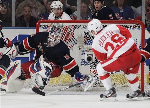 New York Rangers goalie Henrik Lundqvist (30), of Sweden, stops a shot on the goal by Detroit Red Wings' Jiri Hudler (26) during the second period of an NHL hockey game Wednesday, March 21, 2012, in New York. (AP Photo/Frank Franklin II)