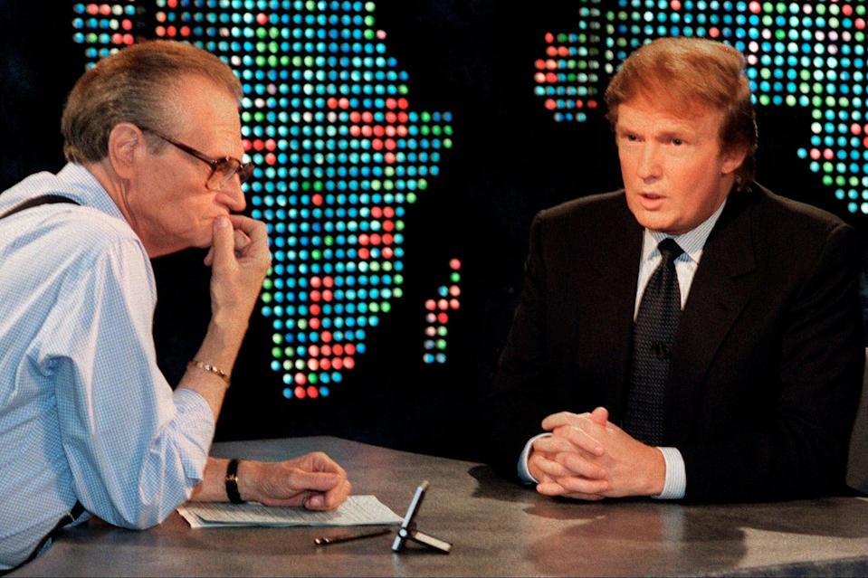Donald Trump, right, is interviewed by Larry King during a taping of 'Larry King Live' in New York (file picture from 1999)AP