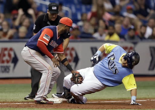 Tampa Bay Rays' Ji-Man Choi, right, of South Korea, beats the tag by Boston Red Sox second baseman Eduardo Nunez for an RBI-triple during the eighth inning of a baseball game Saturday, Aug. 25, 2018, in St. Petersburg, Fla. Rays' Matt Duffy scored. Umpire Angel Hernandez makes the call. (AP Photo/Chris O'Meara)
