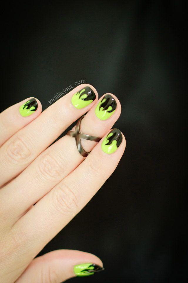 <p>Forget the traditional orange and black tips this Halloween. Trade 'em for these lime green nails with eerie flame silhouettes. Spooooooky! </p>