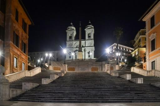 The Spanish Steps in Rome are deserted after sunset, after Italy imposed unprecedented restrictions to check the spread of the new coronavirus and the death toll soared to 631 people