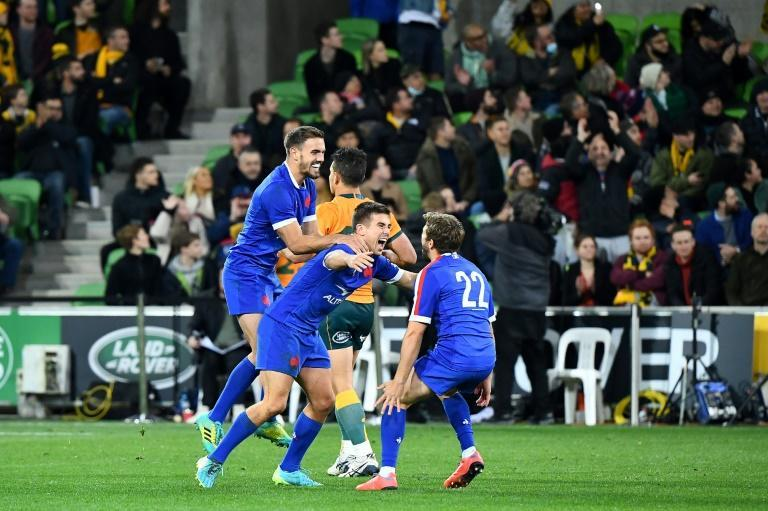 France's Melvyn Jaminet, Louis Carbonel and Teddy Iribaren celebrate a first Les Bleus win in Australia since 1990, this month's second Test