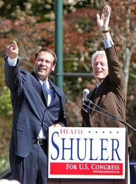 Heath Shuler stands with Bill Clinton at a campaign event.