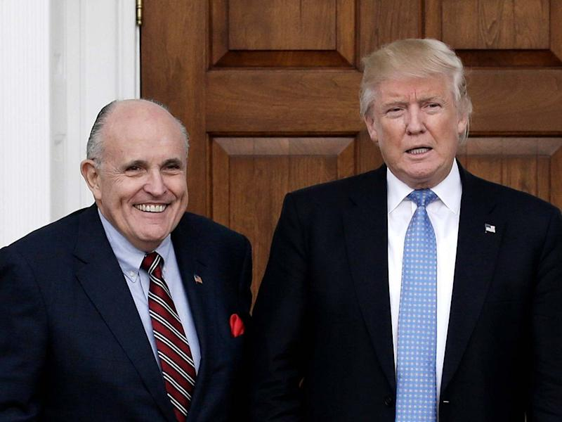 Donald Trump's personal lawyer Rudy Giuliani (left) with the US president (right): Peter Foley/EPA