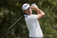 Patrick Cantlay hits from the tee on the third hole during second round play in the Tour Championship golf tournament at East Lake Golf Club, Friday, Sept. 3, 2021, in Atlanta. (AP Photo/Brynn Anderson)