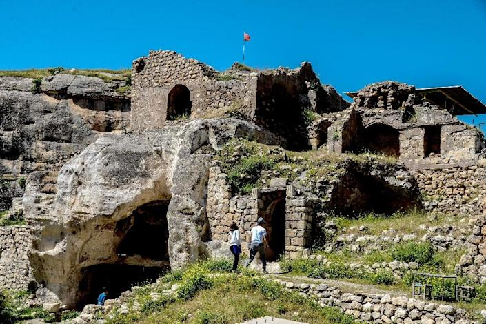 The caves in the cliffs overlooking Hasankeyf, which has been home to Romans, Byzantines and Turkik tribes over 10,000 years of human settlement (AFP Photo/ILYAS AKENGIN)