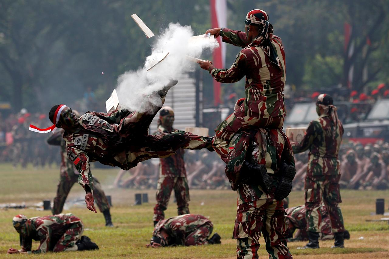An Indonesian army special forces soldiers perform martial arts during celebrations for the 67th anniversary of the Indonesian Army Special Forces in Jakarta, Indonesia, April 24, 2019. REUTERS/Willy Kurniawan     TPX IMAGES OF THE DAY