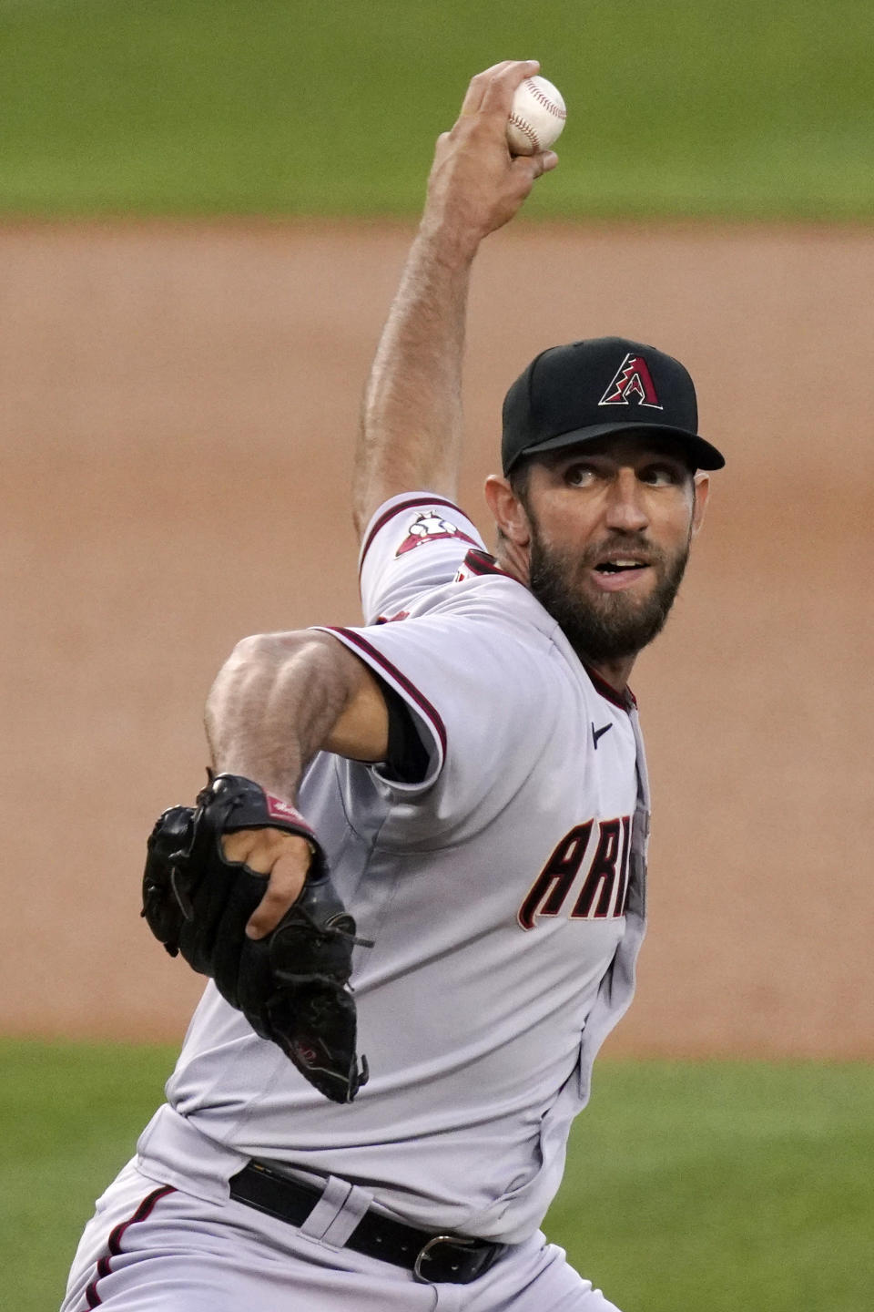 Arizona Diamondbacks starting pitcher Madison Bumgarner throws to the plate during the first inning of a baseball game against the Los Angeles Dodgers Monday, May 17, 2021, in Los Angeles. (AP Photo/Mark J. Terrill)