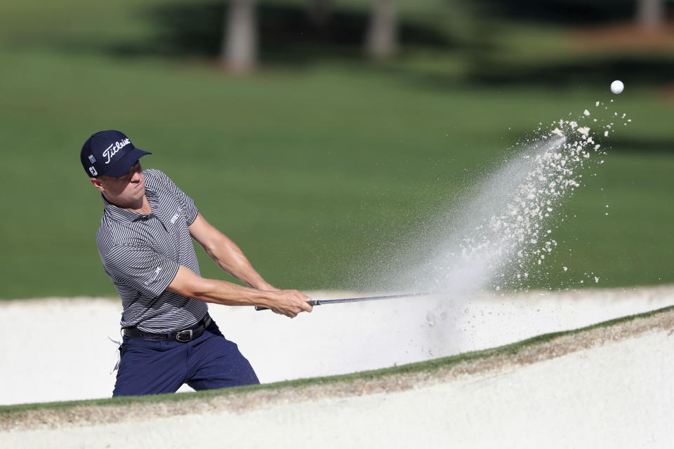 Justin Thomas hits out of the bunker on the 7th green during the second round of the Masters Friday, Nov. 13, 2020, in Augusta, Ga. (Curtis Compton/Atlanta Journal-Constitution via AP)