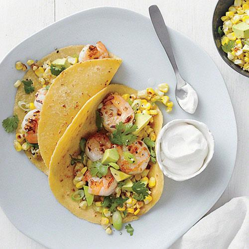 """<p>Tossing the shrimp in a little honey before cooking helps to create tasty grill marks.</p> <p> <a rel=""""nofollow noopener"""" href=""""http://www.myrecipes.com/recipe/shrimp-tacos-corn-salsa"""" target=""""_blank"""" data-ylk=""""slk:View Recipe: Shrimp Tacos with Corn Salsa"""" class=""""link rapid-noclick-resp"""">View Recipe: Shrimp Tacos with Corn Salsa</a></p>"""