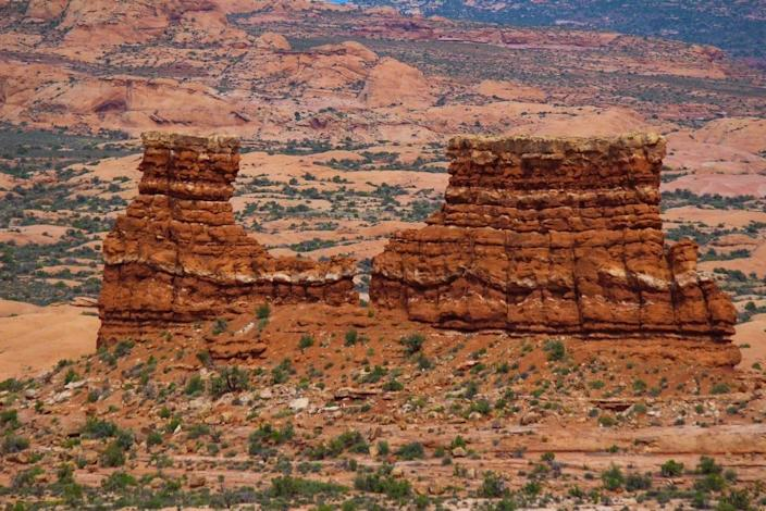 As you drive through Canyonlands National Park, the geological wonders seem endless. The astonishing Monitor and Merrimac rock formations stand out in the distance. The two buttes, named after two Civil War steamships, provide easy hiking and an excellent photo opportunity.