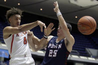Arizona center Chase Jeter, left, passes the ball away from Pennsylvania forward AJ Brodeur during the first half of an NCAA college basketball game at the Wooden Legacy tournament in Anaheim, Calif., Friday, Nov. 29, 2019. (AP Photo/Alex Gallardo)