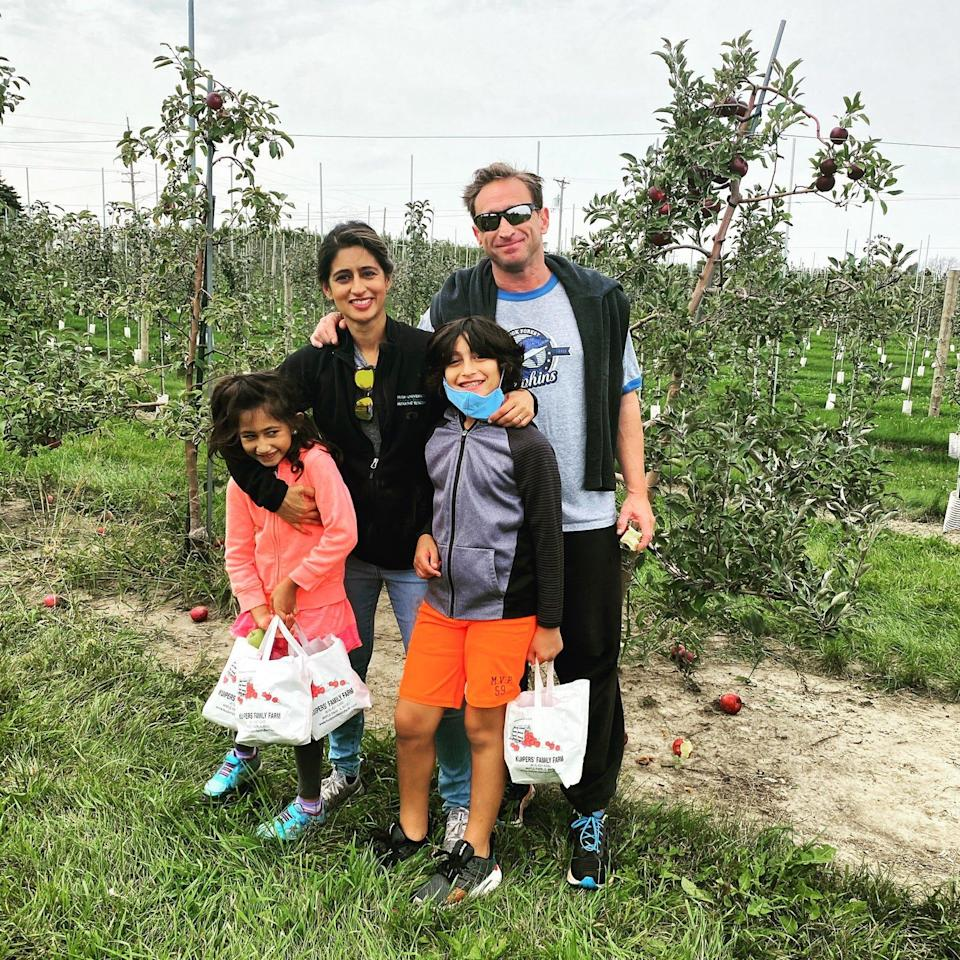 Ami Shah and Steven Salzman with their son, Jai Salzman, and daughter, Alina Salzman, apple picking in the suburbs of Chicago, Illinois, in the fall of 2020.
