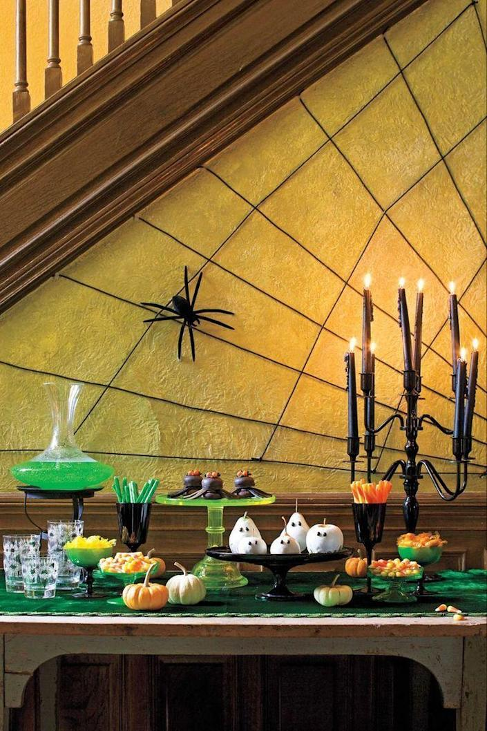 """<p>Use black rope to weave a web on any wall in your home (though the wall underneath a staircase makes the best choice for this display).</p><p><a class=""""link rapid-noclick-resp"""" href=""""https://www.amazon.com/Amarine-made-Twisted-Dockline-Multipurpose-Utility/dp/B07FCCP3QG?tag=syn-yahoo-20&ascsubtag=%5Bartid%7C10070.g.1908%5Bsrc%7Cyahoo-us"""" rel=""""nofollow noopener"""" target=""""_blank"""" data-ylk=""""slk:SHOP BLACK ROPE"""">SHOP BLACK ROPE</a></p>"""