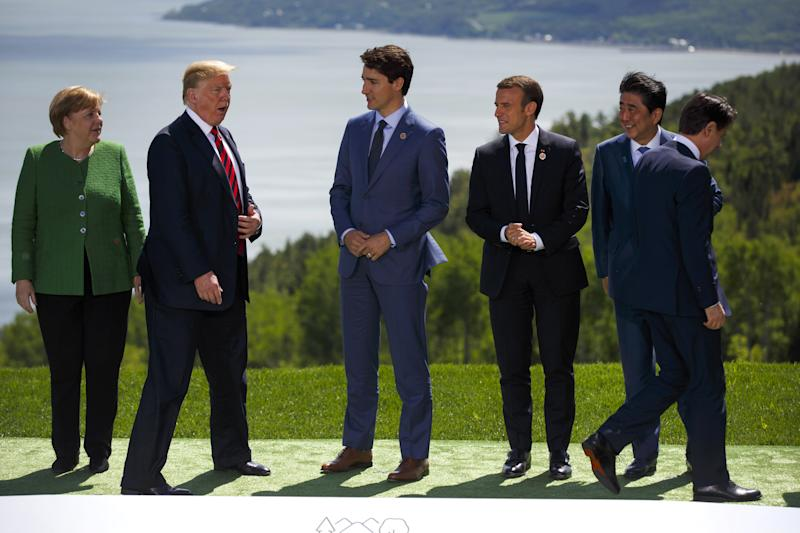 (Left to right) Germany's Angela Merkel, the United States' Donald Trump, Canada's Justin Trudeau, France's Emmanuel Macron, Japan's Shinzo Abe and Italy's Giuseppe Conte get in place for a photo during the G-7 summit in Canada on Friday. (Bloomberg via Getty Images)