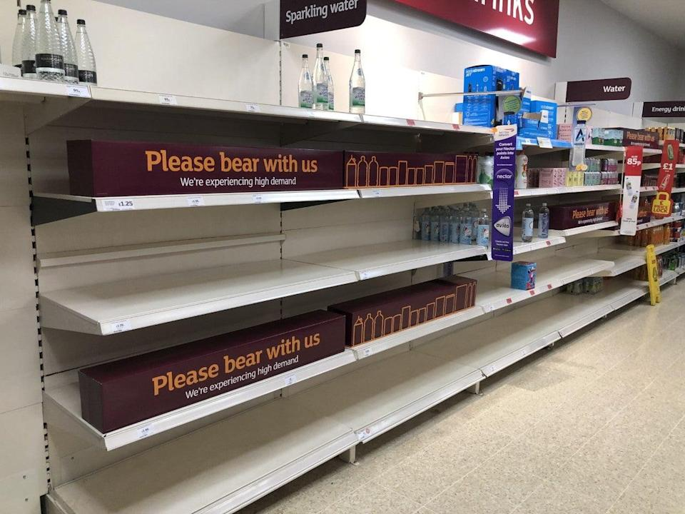 Empty shelves and signs on the soft drinks aisle of a Sainsbury's store in Blackheath, Rowley Regis in the West Midlands. Supermarkets have urged customers not to panic buy (PA) (PA Wire)