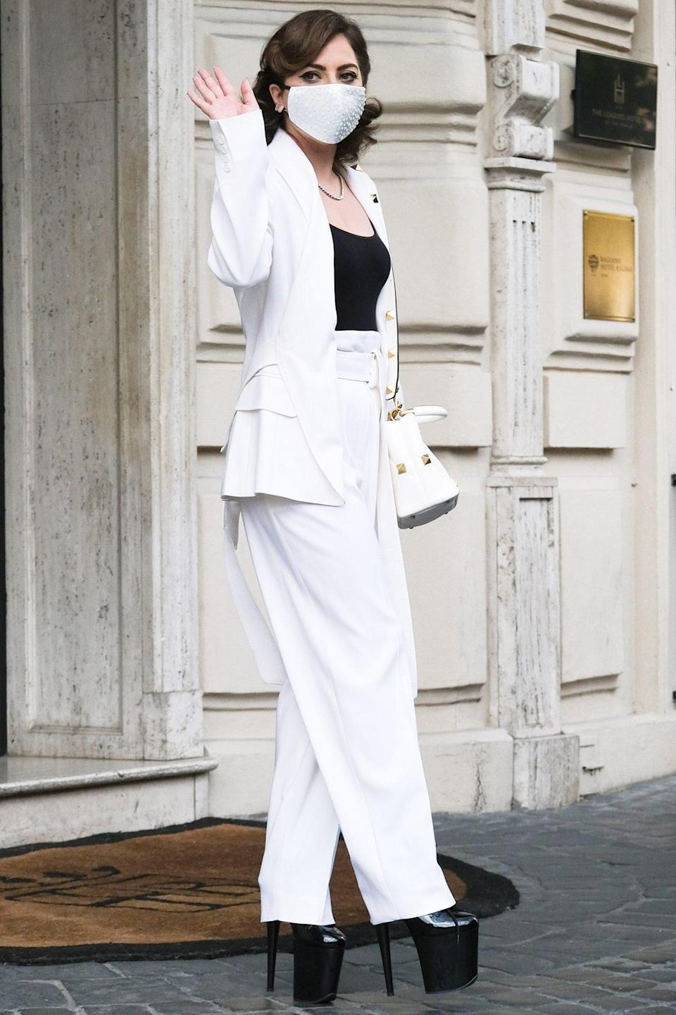 <p>Lady Gaga steps out in a chic, black-and-white ensemble and sky-high heels in Rome on Thursday.</p>