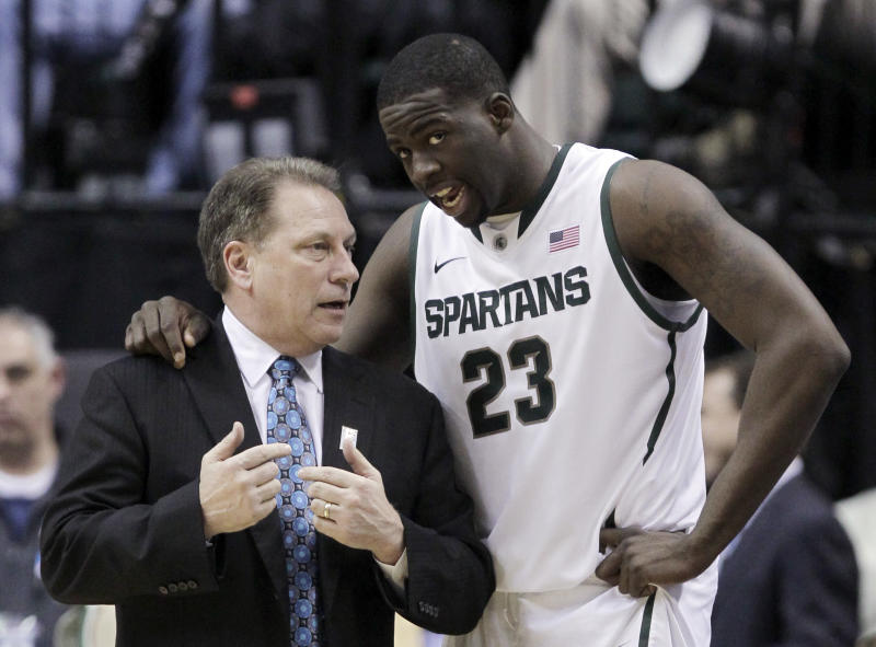 Michigan State head coach Tom Izzo talks to Michigan State forward Draymond Green (23) in the first half of an NCAA college basketball game against Iowa in the second round of the Big Ten Conference tournament in Indianapolis, Friday, March 9, 2012. (AP Photo/Michael Conroy)