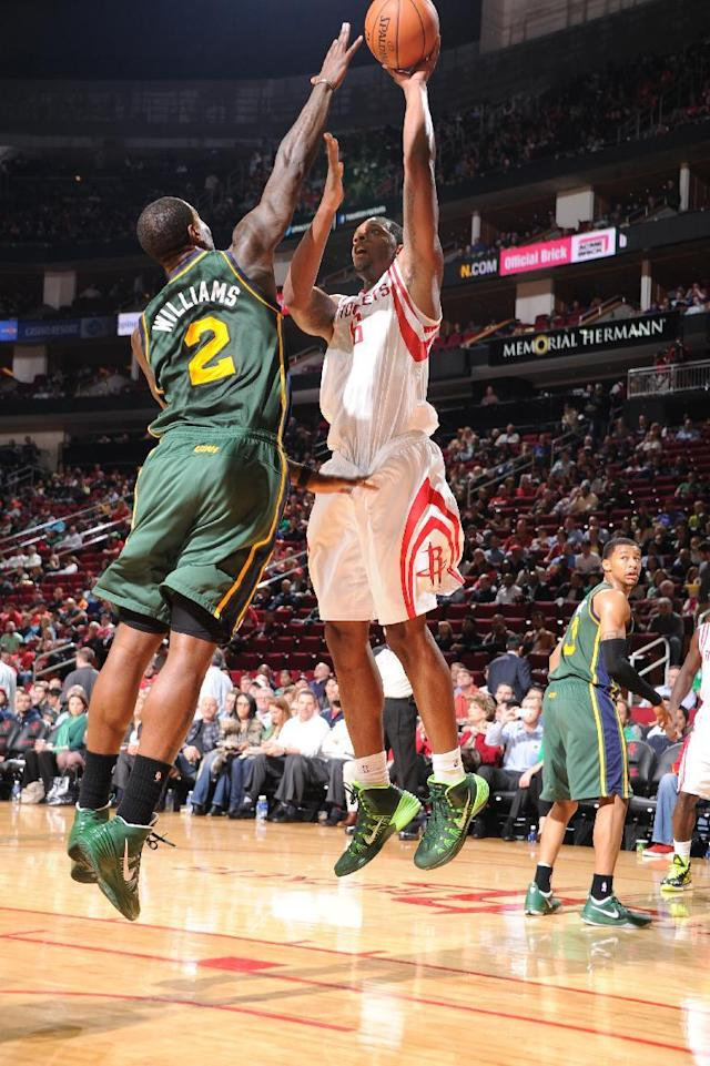 HOUSTON, TX - MARCH 17: Terrence Jones #6 of the Houston Rockets shoots against Marvin Williams #2 of the Utah Jazz on March 17, 2014 at the Toyota Center in Houston, Texas. (Photo by Bill Baptist/NBAE via Getty Images)