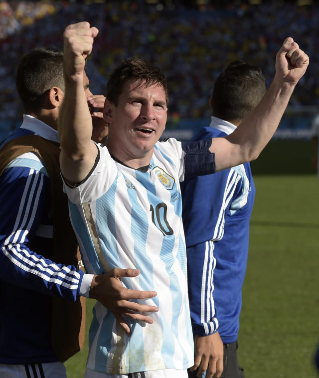 Argentina's Lionel Messi celebrates after Angel di Maria scored his side's only and winning goal in extra time during the World Cup round of 16 soccer match between Argentina and Switzerland at the Itaquerao Stadium in Sao Paulo, Brazil, Tuesday, July 1, 2014. Argentina defeated Switzerland 1-0 to move on to the quarterfinals. (AP Photo/Manu Fernandez)