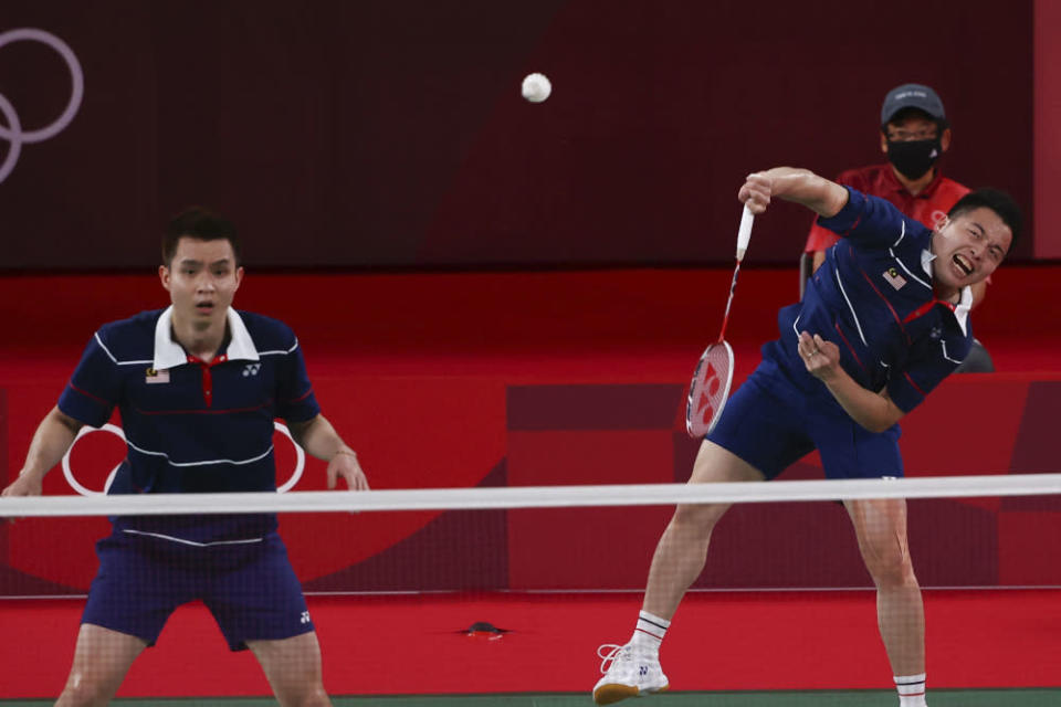 Malaysia's Aaron Chia and Soh Wooi Yik in action during the Tokyo 2020 Olympics badminton Men's Doubles bronze medal match against Indonesia's Mohammad Ahsan and Hendra Setiawan at the Musashino Forest Sport Plaza, Tokyo July 31, 2021. — Reuters pic