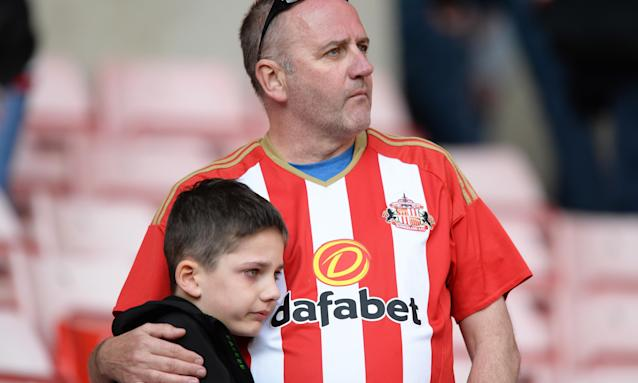 A couple of Sunderland supporters react to the club's relegation from the Championship following their 2-1 defeat to Burton Albion at the Stadium of Light on Saturday.