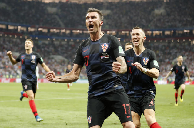 <p>Mario Mandzukic celebrates after putting Croatia into a 2-1 lead in extra time </p>