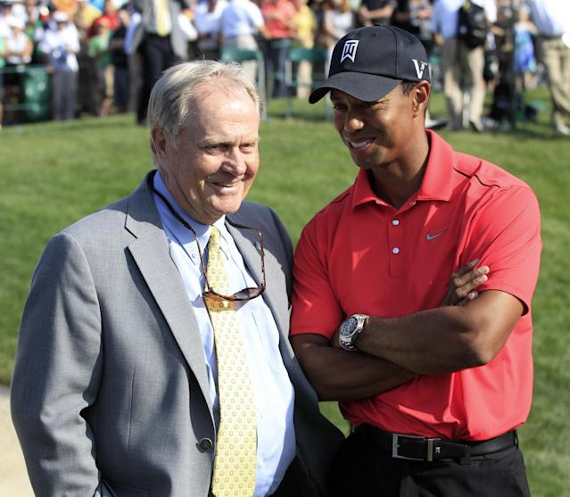 """CORRECT DATE TO JUNE 3, NOT JUNE 2 - FILE - In this June 3, 2012, file photo, Jack Nicklaus, left, talks with Tiger Woods after Woods won the Memorial golf tournament at the Muirfield Village Golf Club in Dublin, Ohio. Four years ago, with a major championship lineup of courses that favored Woods, Nicklaus said it would be a """"big year"""" for Woods if he was going to break Nicklaus' record. The same might be true for 2014, but Woods' age (38) might be as important as where the majors are played. (AP Photo/Tony Dejak, File)"""