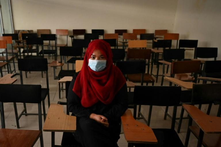 Women students in Afghanistan face tough new restrictions on their clothing and movement as universities reopen in Kabul on September 6 under a new Taliban rule (AFP/Aamir QURESHI)