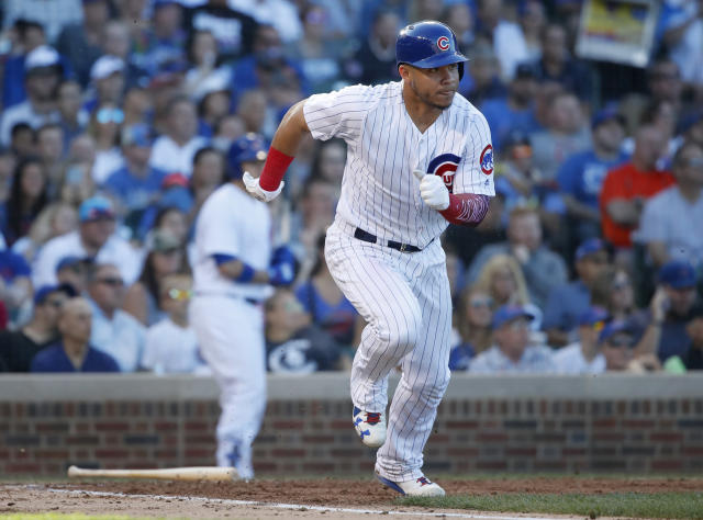 Chicago Cubs' Willson Contreras watches his RBI single against the Cincinnati Reds during the sixth inning of a baseball game in Chicago, on Saturday, Sept. 15, 2018. (AP Photo/Jeff Haynes)