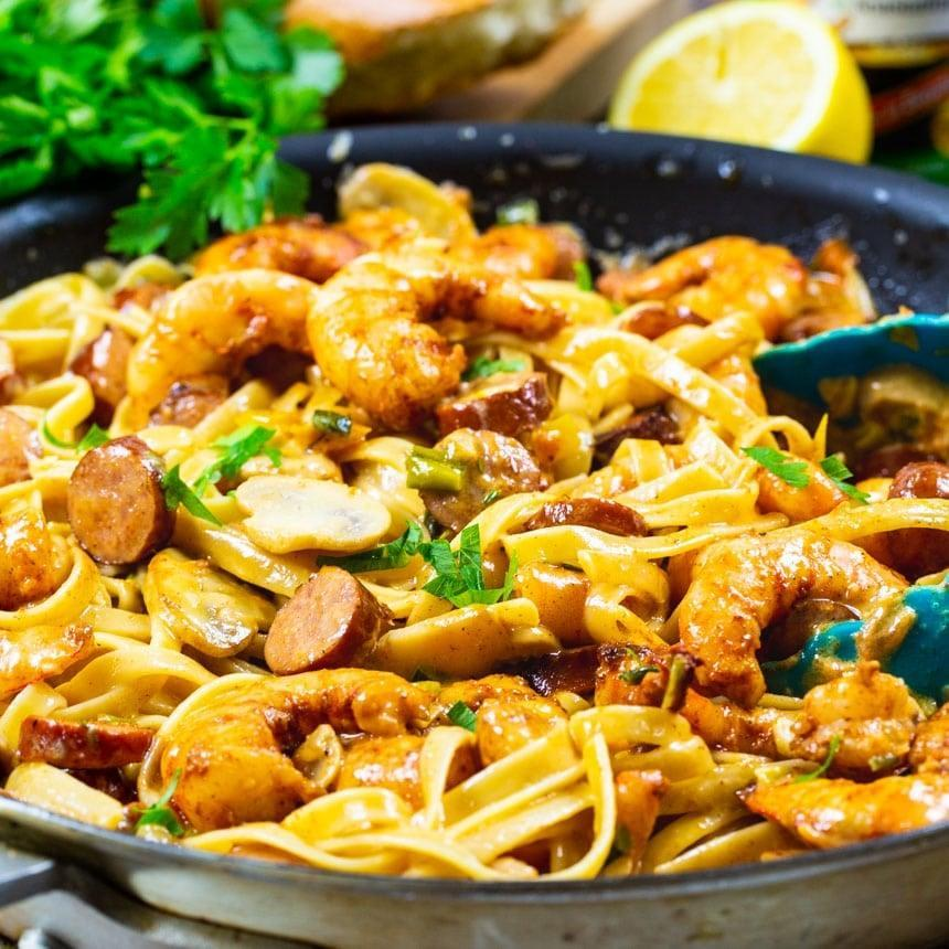 """<p>Imagine: a Cajun-style fettuccine alfredo. Yum! This quick pasta recipe only takes 20 minutes to make, and features shrimp, andouille sausage, peppers, and garlic. Whip it up whenever you're missing the flavors of the South.</p> <p><strong>Get the recipe</strong>: <a href=""""https://spicysouthernkitchen.com/mardi-gras-pasta/"""" class=""""link rapid-noclick-resp"""" rel=""""nofollow noopener"""" target=""""_blank"""" data-ylk=""""slk:Mardi Gras pasta"""">Mardi Gras pasta</a></p>"""