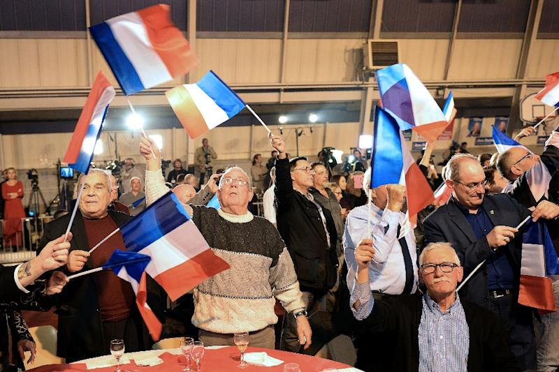 Supporters of the far-right National Front (FN) celebrate after the first round of the regional elections in the Provence-Alpes-Cote d'Azur (PACA) region, on December 6, 2015 (AFP Photo/Boris Horvat)